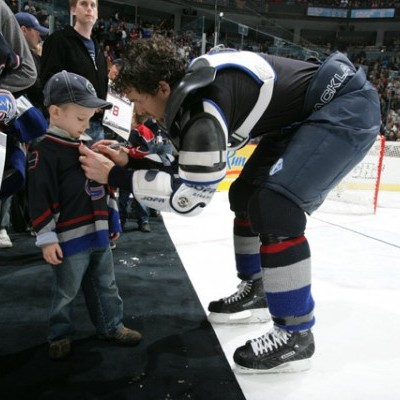 Trevor Signs a Young Fans Jersey